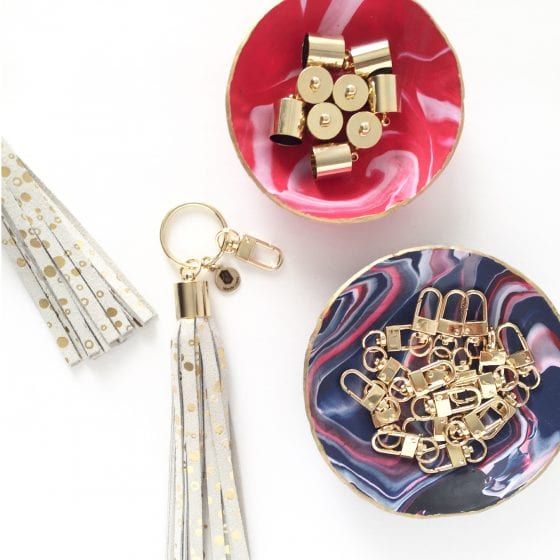 Wanda Lopez Designs gold dot genuine leather tassel keychain product and some words about Complain vs Master in the blog www.wandalopez.com